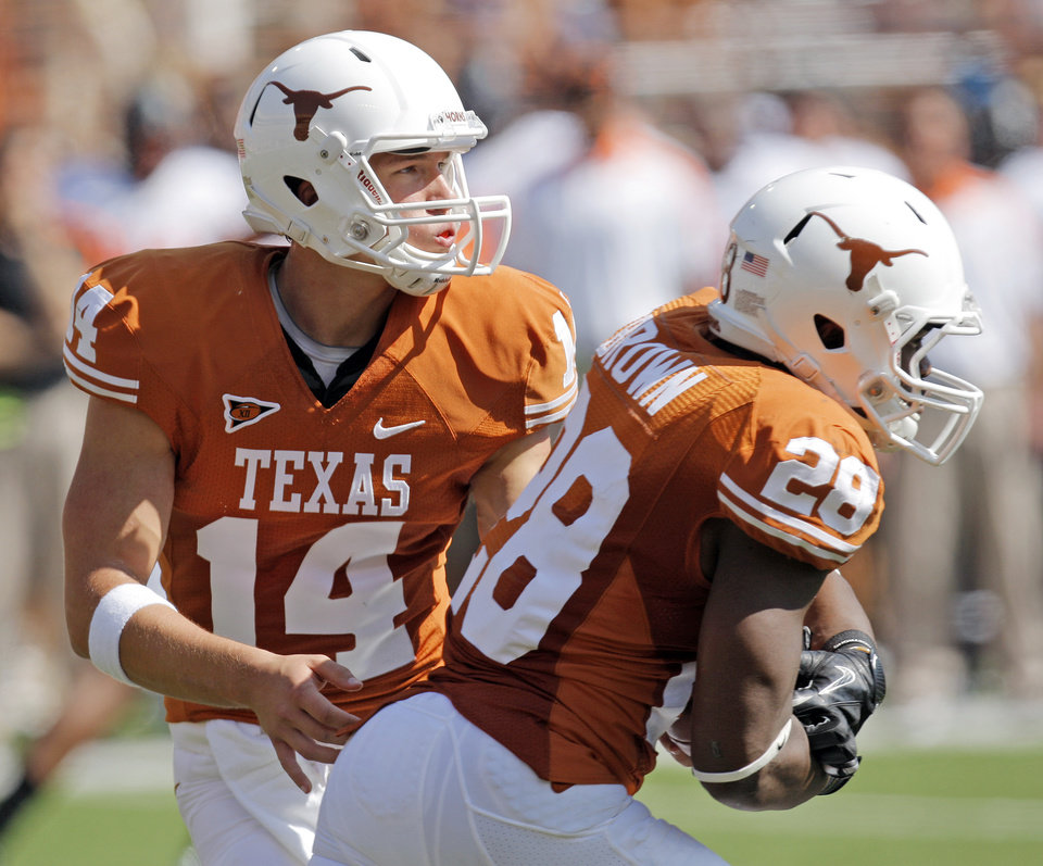 Texas\' David Ash (14) hands the ball off to Texas\' Malcolm Brown (28) in the first half during a college football game between the Oklahoma State University Cowboys (OSU) and the University of Texas Longhorns (UT) at Darrell K Royal-Texas Memorial Stadium in Austin, Texas, Saturday, Oct. 15, 2011. Photo by Nate Billings, The Oklahoman ORG XMIT: KOD