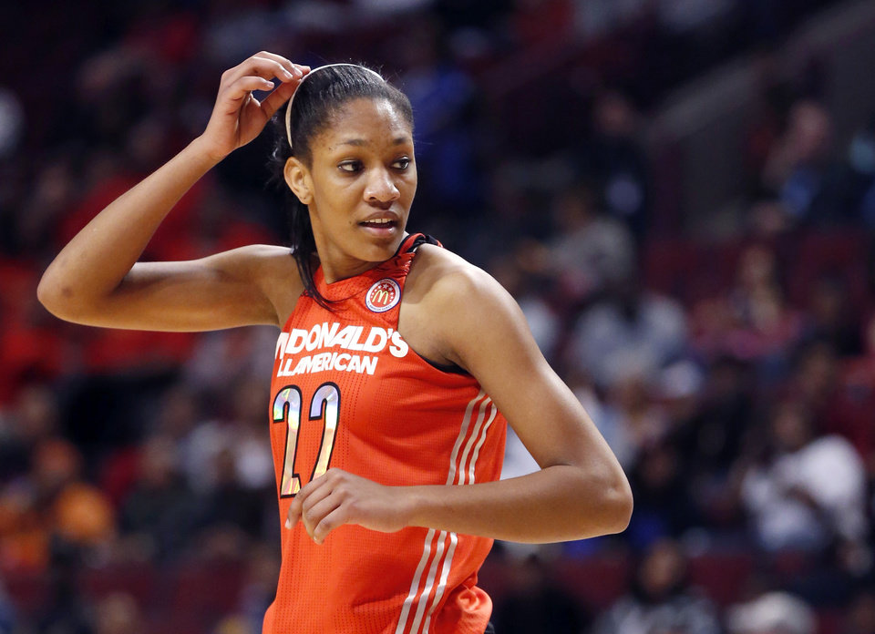 Photo - FILE - In this April 2, 2014, file photo, McDonald's East All American A'ja Wilson adjusts her head band during the first half of the McDonald's All-American girls' basketball game in Chicago. After a landmark season that saw the South Carolina win the Southeastern Conference regular-season title and earn a No. 1 seed in the NCAA tournament, coach Dawn Staley landed the country's top college prospect in Wilson, setting off championship dreams among the fans who've gotten on board with the rising program. (AP Photo/Charles Rex Arbogast, File)