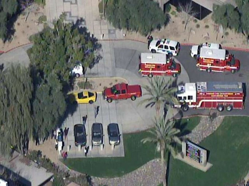 This frame grab provided by abc15.com shows the scene at a Phoenix office complex where police say someone shot at least three people on Wednesday, Jan. 30, 2013. Officer James Holmes said the victims were taken to hospitals and did not know if their injuries were life threatening. (AP Photo/abc15.com) MANDATORY CREDIT  ORG XMIT: NY114