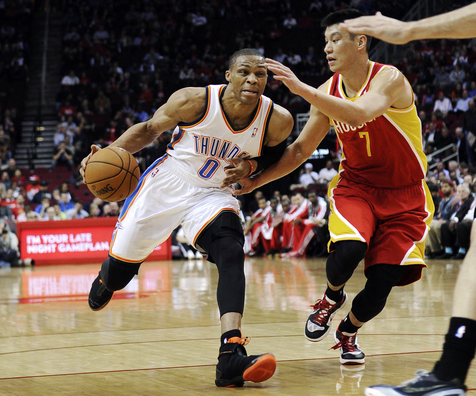 Houston Rockets\' Jeremy Lin (7) defends against Oklahoma City Thunder\'s Russell Westbrook (0) in the first half of an NBA basketball game, Wednesday, Feb. 20, 2013, in Houston. (AP Photo/Pat Sullivan)