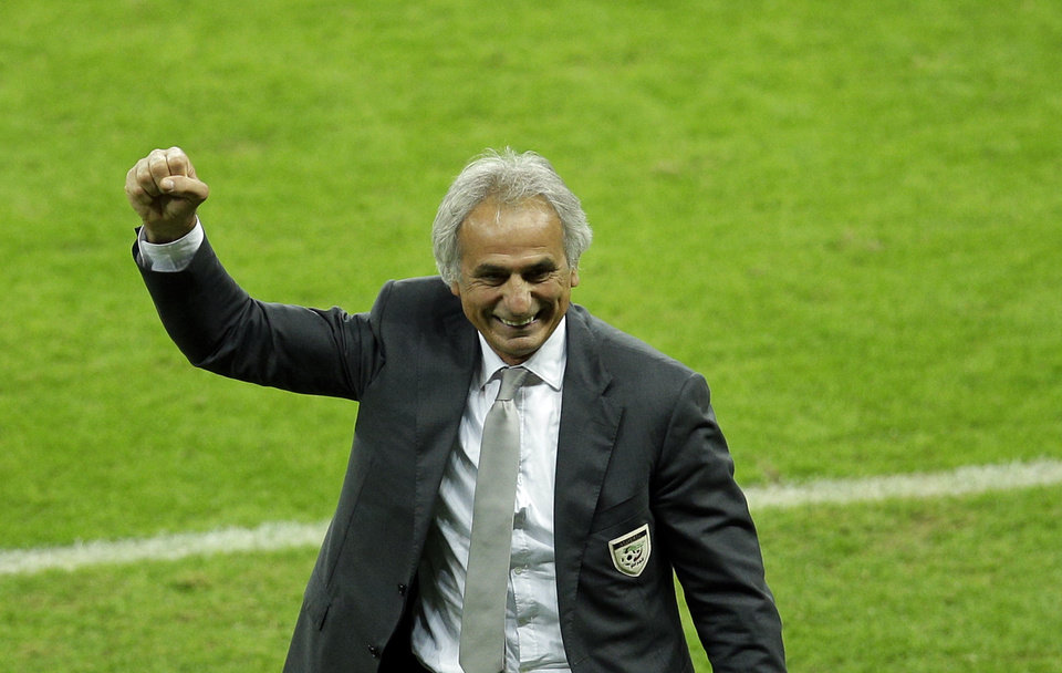 Photo - Algeria's head coach Vahid Halilhodzic celebrates after his side won the game 4-2 in the group H World Cup soccer match between South Korea and Algeria at the Estadio Beira-Rio in Porto Alegre, Brazil, Sunday, June 22, 2014. (AP Photo/Michael Sohn)
