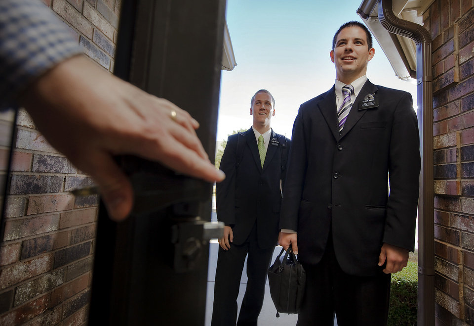 Elder Joel L. Heyland and Elder Derrickj T. Nield, both Mormon missionaries in the metro area, pose for a photo Wednesday in Oklahoma City. <strong>CHRIS LANDSBERGER - CHRIS LANDSBERGER</strong>