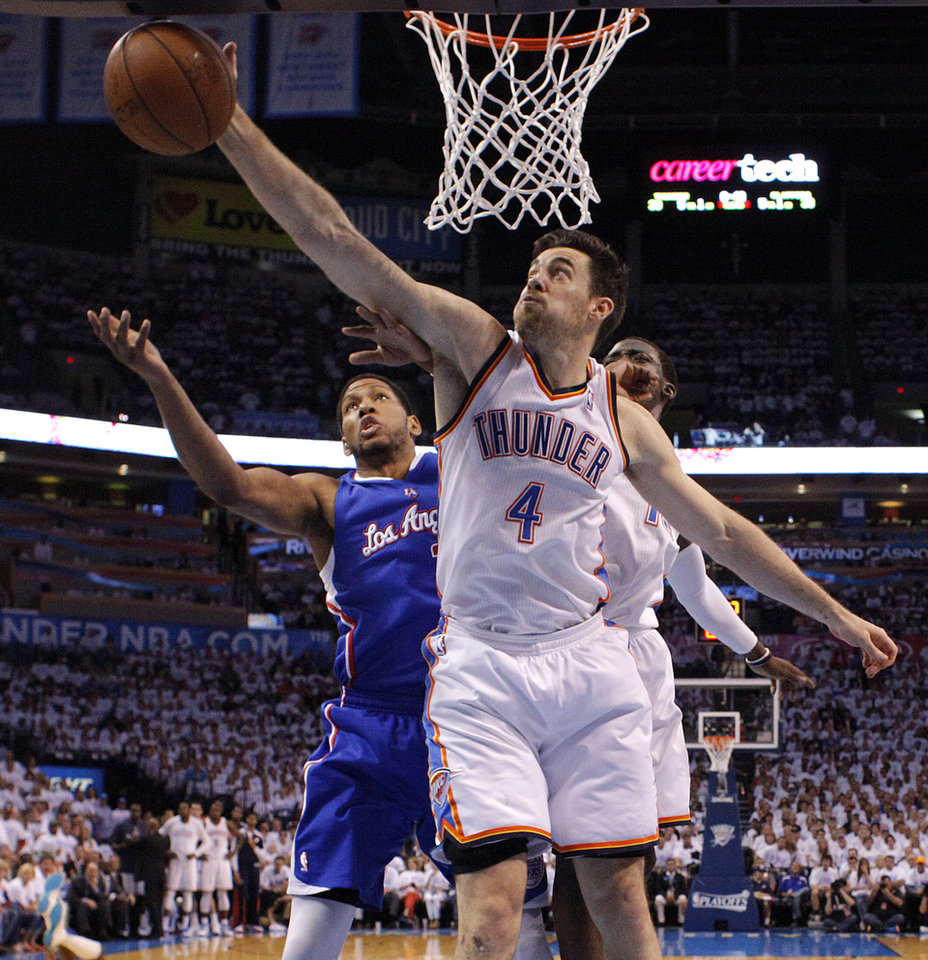Oklahoma City's Nick Collison (4) goes for a rebound in front of Los Angeles' Danny Granger (33) during Game 5 of the Western Conference semifinals in the NBA playoffs between the Oklahoma City Thunder and the Los Angeles Clippers at Chesapeake Energy Arena in Oklahoma City, Tuesday, May 13, 2014. Photo by Bryan Terry, The Oklahoman