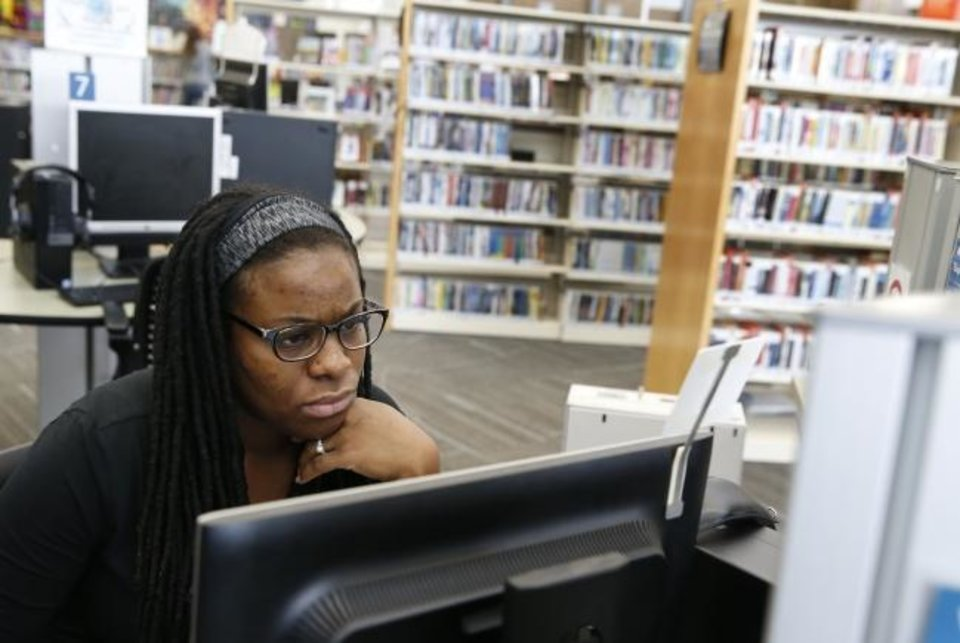 Photo -  Moneek Odunze uses a computer at the Ralph Ellison Library, 2000 NE 23, in Oklahoma City, Friday, Feb. 7, 2020. [Nate Billings/The Oklahoman]