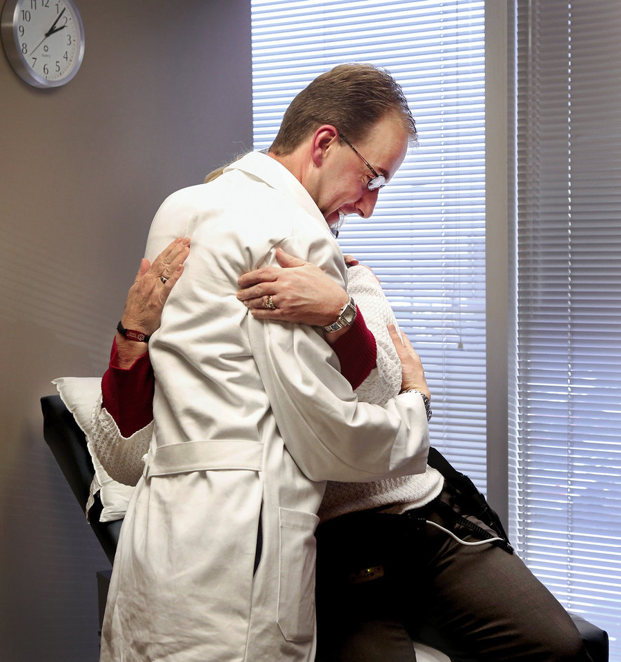 Pam Golden of Longtown gives her cardiologist, Dr. Douglas Horstmanshof, a hug before he leaves the examining room during Golden\'s visit to Horstmanshof\'s office in Oklahoma City this week. Golden had a LVAD (left ventricular assistance device) implanted in her body to improve her circulation system. Photographed at Integris Baptist Hospital on Monday, Jan. 14, 2013. Photo by Jim Beckel, The Oklahoman