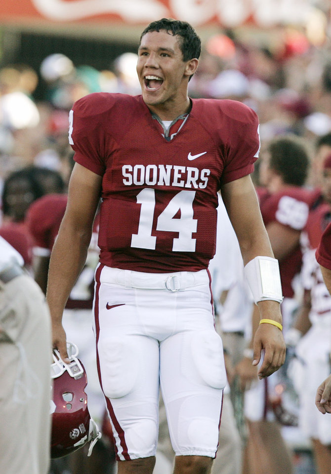Photo - CELEBRATE, CELEBRATION: Oklahoma quarterback Sam Bradford smiles as he celebrates on the sideline after throwing his first touchdown pass of his career at Oklahoma in the first half during the University of Oklahoma Sooners (OU) college football game against the University of North Texas Mean Green (UNT) at the Gaylord Family -- Oklahoma Memorial Stadium, on Saturday, Sept. 1, 2007, in Norman, Okla.   By BILL WAUGH, The Oklahoman  ORG XMIT: KOD