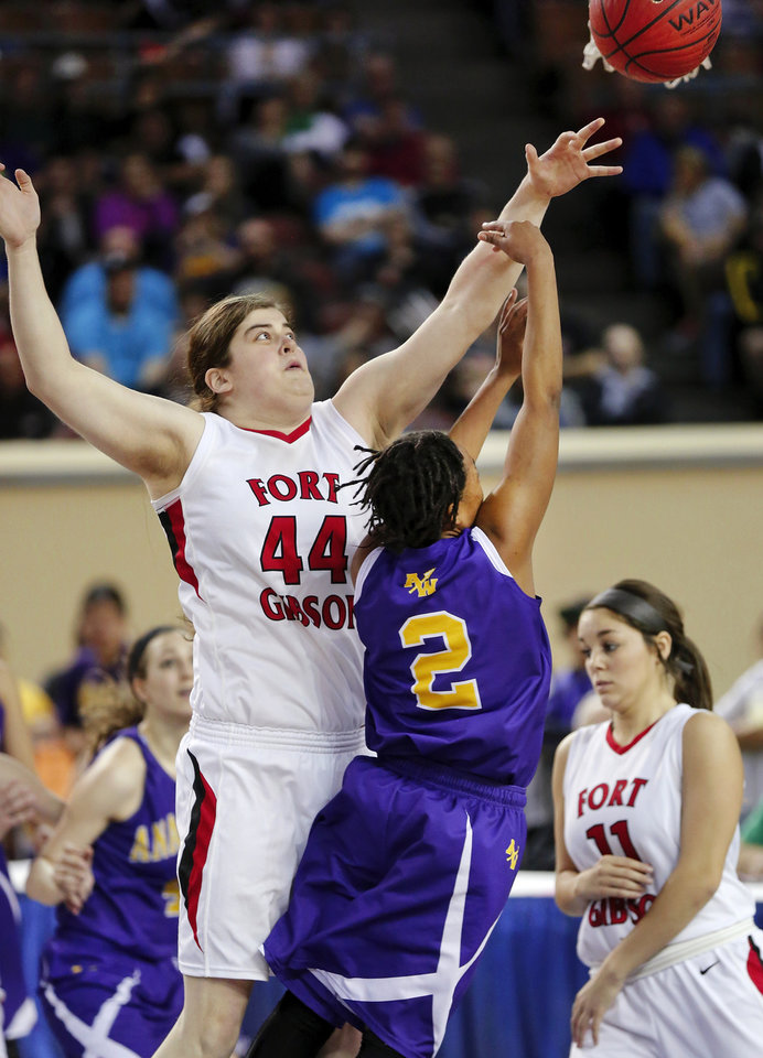 Photo - Ft. Gibson's Susie Kilpatrick guards Anadarko shooter Tandra King during the Class 4A State championship game between Ft. Gibson and Anadarko at Jim Norick Arena at State Fair Park  on Saturday, Mar. 15, 2014. Ft. Gibson came from behind much of the second half to win 50-47.  Photo by Jim Beckel, The Oklahoman