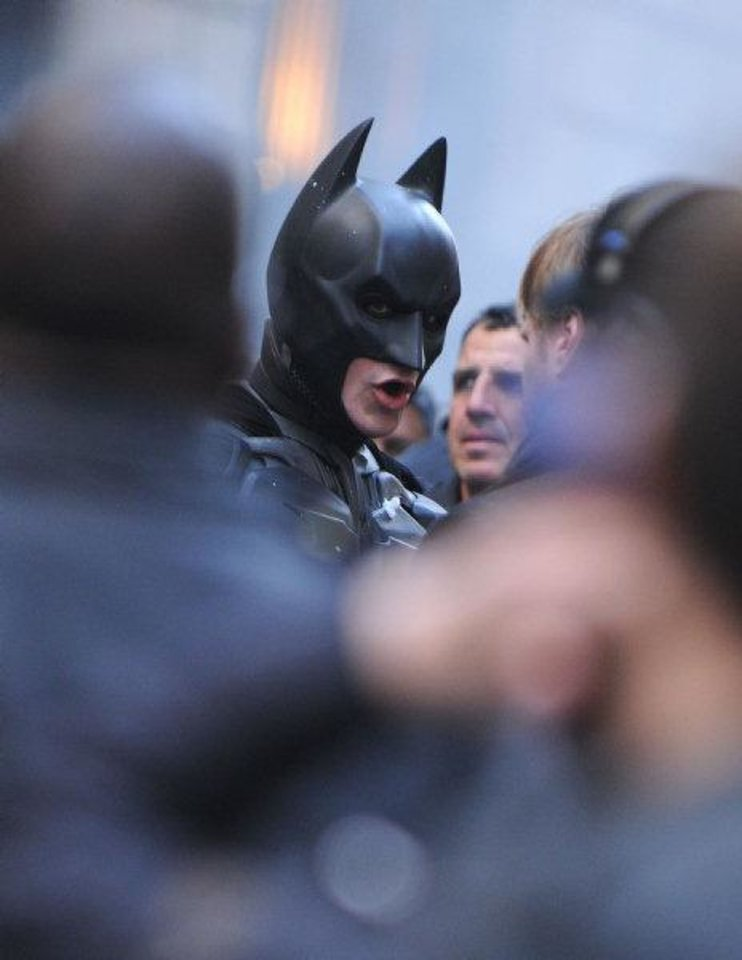 "Actor Christian Bale speaks on the set of the latest Batman film, ""The Dark Knight Rises"" on Wall Street in New York, on Sunday, Nov. 6, 2011. (AP Photo/Darla Khazei)"
