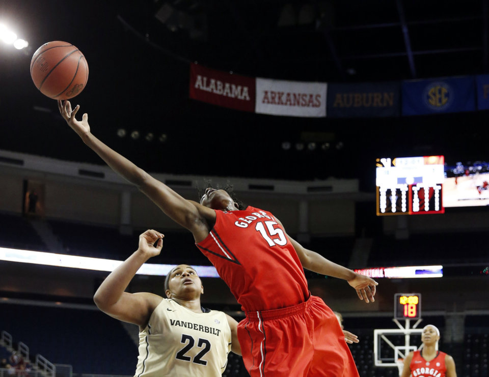 Photo - Georgia's Krista Donald (15) reaches for a high pass as Vanderbilt forward Marqu'es Webb (22) defends in the first half of a second-round women's Southeastern Conference tournament NCAA college basketball game Thursday, March 6, 2014, in Duluth, Ga. (AP Photo/John Bazemore)