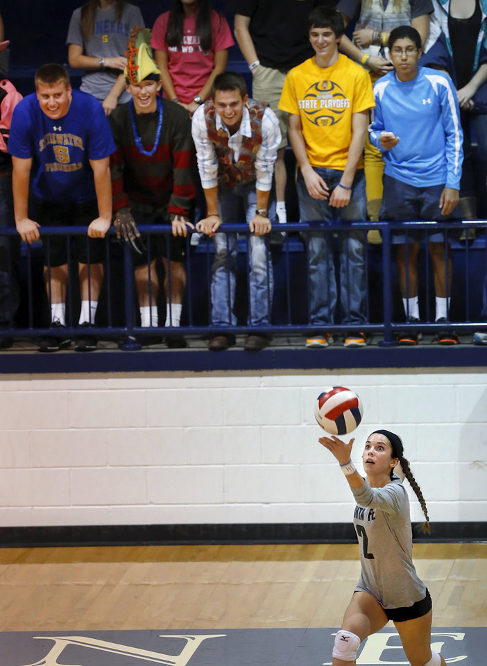 Santa Fe senior  Mandy Dolph serves the ball  to Stillwater in front of partisan Stillwater students in first round action during Stillwater vs. Edmond Santa Fe game in Class 6A volleyball tournament at Shawnee High School on Friday, Oct. 12, 2012.   Photo by Jim Beckel, The Oklahoman
