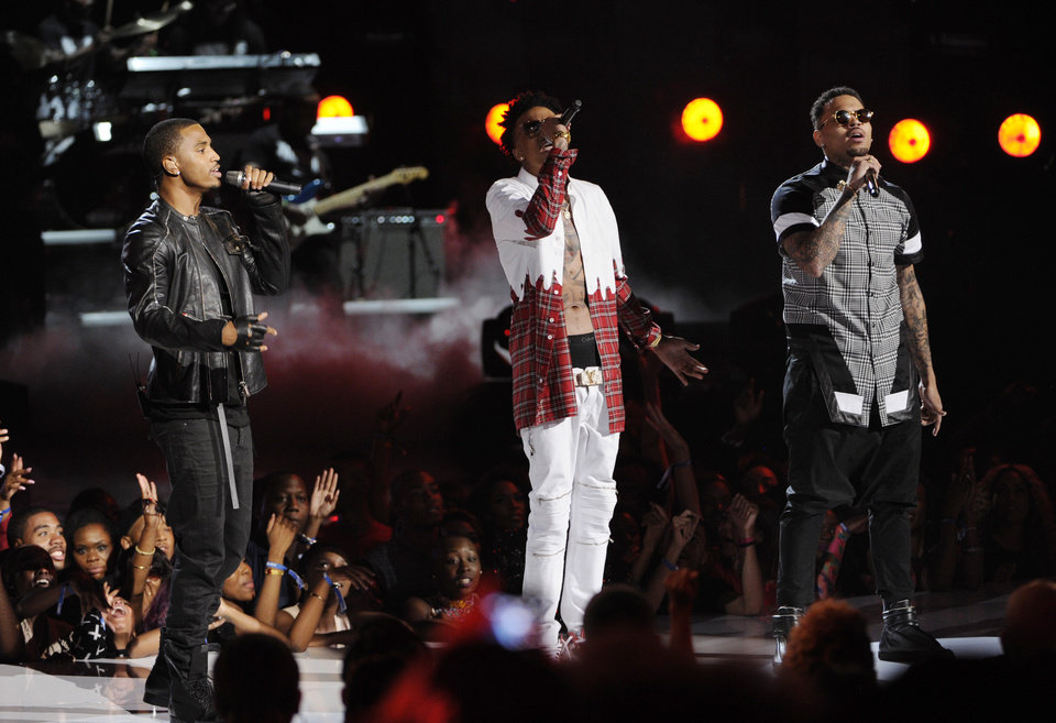 Photo - Trey Songz, from left, August Alsina and Chris Brown perform at the BET Awards at the Nokia Theatre on Sunday, June 29, 2014, in Los Angeles. (Photo by Chris Pizzello/Invision/AP)