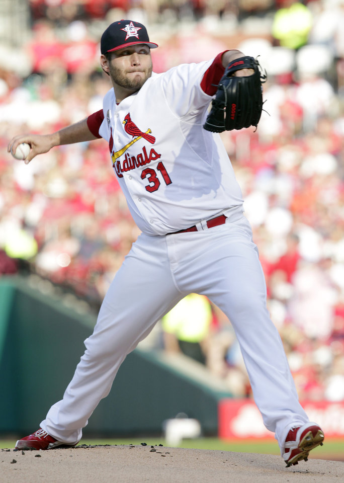 Photo - St. Louis Cardinals starting pitcher Lance Lynn sets to throw in the first  inning of a baseball game against the Miami Marlins, Friday, July 4, 2014, in St. Louis.(AP Photo/Tom Gannam)