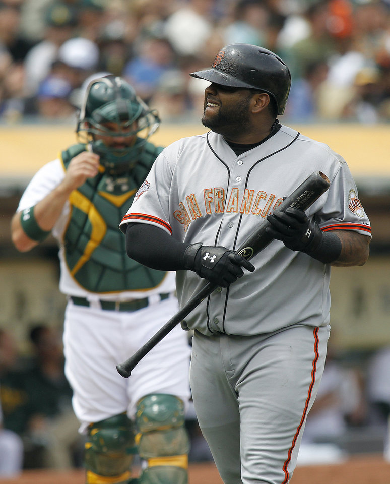 Photo - San Francisco Giants' Pablo Sandoval (48) reacts after striking out against the Oakland Athletics during the fourth inning of a baseball game in Oakland, Calif., Monday, May 27, 2013. (AP Photo/Tony Avelar)