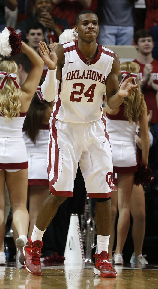 Photo - Oklahoma Sooner Buddy Hield (24) reacts to play in the second half as the University of Oklahoma Sooners (OU) men defeat the Texas Longhorns (TU) 77-65 in NCAA, college basketball at The Lloyd Noble Center on Saturday, March 1, 2014  in Norman, Okla. Photo by Steve Sisney, The Oklahoman