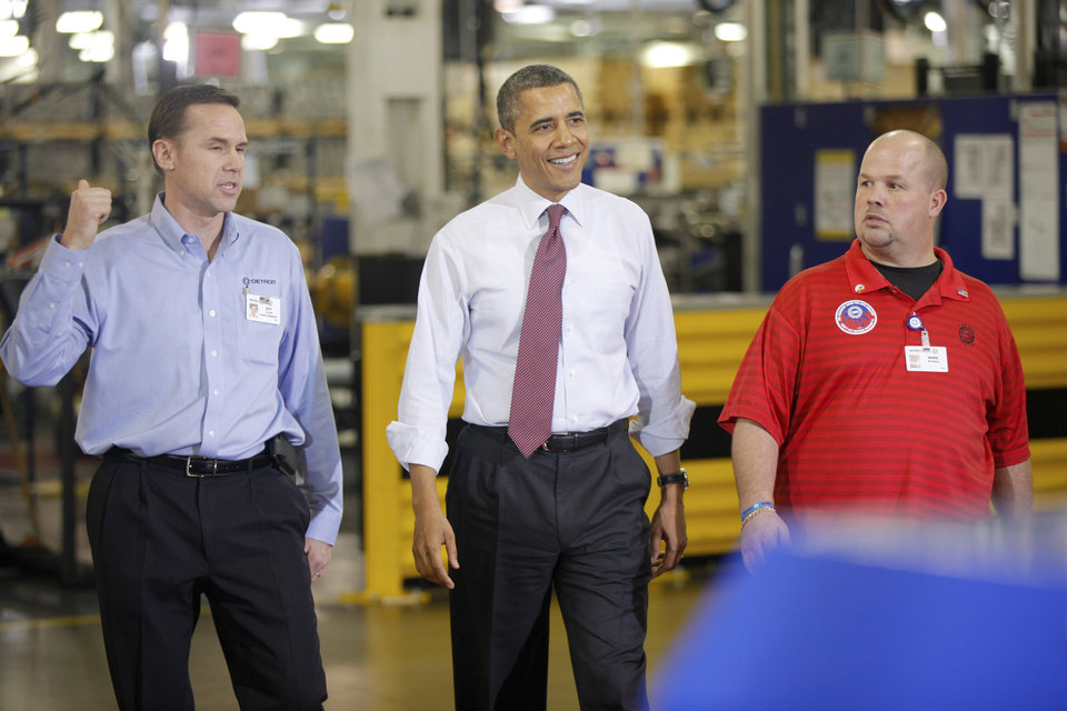 Photo - President Barack Obama walks with Plant Manager and Vice President of Operations Jeff Allen, left, and UAW NW Local 163 Detroit Diesel Engine Unit Shop Chairperson Mark