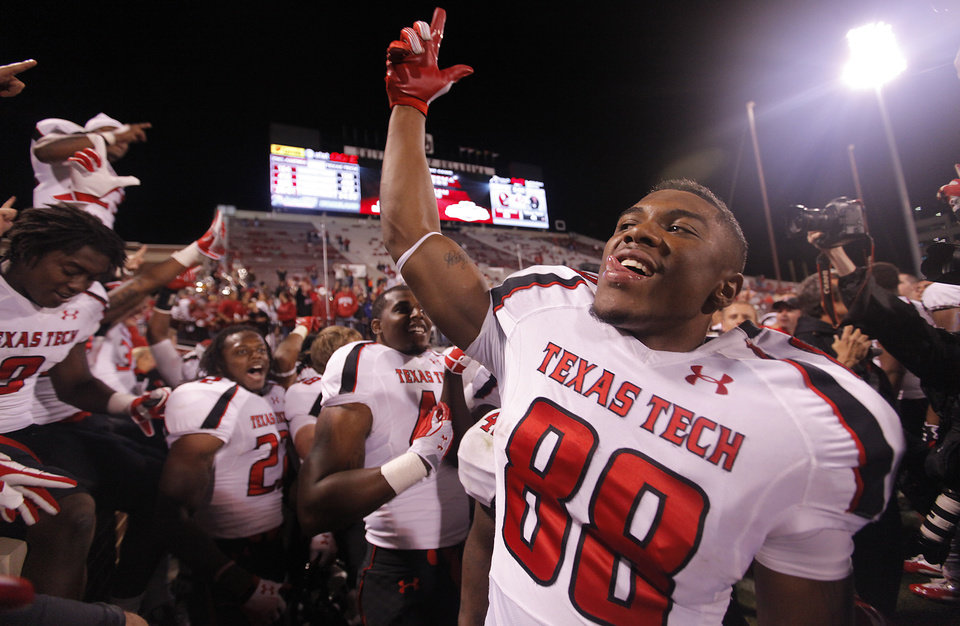 Photo - Texas Tech's Marcus Kennard (88) celebrates after the 41-38 win over Oklahoma during the college football game between the University of Oklahoma Sooners (OU) and Texas Tech University Red Raiders (TTU) at the Gaylord Family-Oklahoma Memorial Stadium on Sunday, Oct. 23, 2011. in Norman, Okla. Photo by Chris Landsberger, The Oklahoman