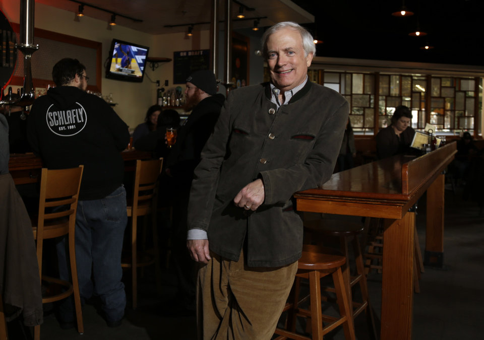 Tom Schlafly, co-founder of the brewery which produces the Schlafly brand of beers, poses for a photo at Schlafly Bottleworks Wednesday, March 12, 2014, in Maplewood, Mo. Schlafly has been in a trademark dispute with his aunt, conservative activist Phyllis Schlafly, over whether Schlafly is primarily a last name or a commercial brand that deserves legal protection. (AP Photo/Jeff Roberson)
