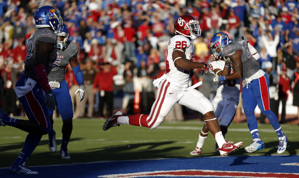 Photo - OU's Damien Williams (26) scores a touchdown in the fourth quarter during of the college football game between the University of Oklahoma Sooners (OU) and the University of Kansas Jayhawks (KU) at Memorial Stadium in Lawrence, Kan., Saturday, Oct. 19, 2013. OU won 34-19. Photo by Sarah Phipps, The Oklahoman