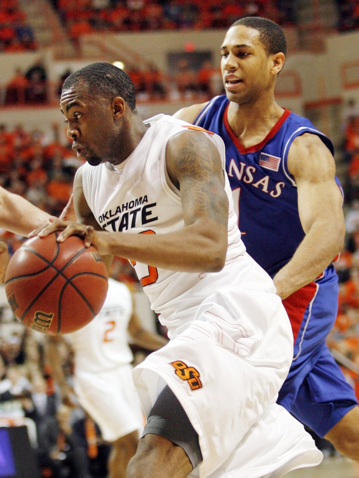 OSU's James Anderson (23) drives past Xavier Henry (1) of KU in the first half during the men's college basketball game between the University of Kansas (KU) and Oklahoma State University (OSU) at Gallagher-Iba Arena in Stillwater, Okla., Saturday, Feb. 27, 2010. Photo by Nate Billings, The Oklahoman