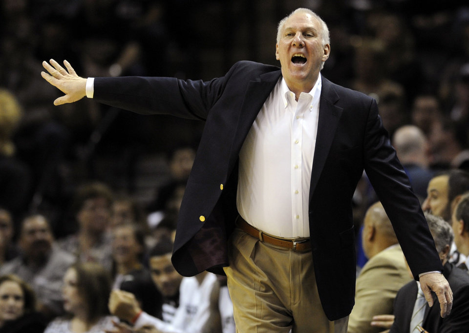 Photo -   FILE - This Dec. 28, 2011 file photo shows San Antonio Spurs head coach Gregg Popovich gesturing during the first half of an NBA basketball game against the Los Angeles Clippers, in San Antonio. Popovich is the NBA's Coach of the Year after leading the San Antonio Spurs to 50 wins in the lockout-shortened season and the No. 1 seed in the Western Conference. The announcement came Tuesday, May 1, 2012. (AP Photo/Bahram Mark Sobhani, File)
