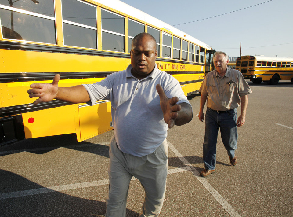 Trainer Bruce Luster briefs new driver trainee Mark English on driving techniques at the Oklahoma City Public Schools Transportation Department in Oklahoma City, OK, Thursday, July 12, 2012. Oklahoma City Public Schools needs bus drivers, and school starts soon.  By Paul Hellstern, The Oklahoman