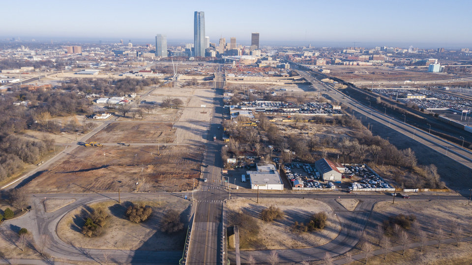 Photo -  Only a handful of salvage operations remain along Robinson Avenue, long known as Hub Cap Alley, following the city acquisition and clearance of the west side of the street as shown in this recent drone photo. [Photo by Dave Morris, The Oklahoman.]