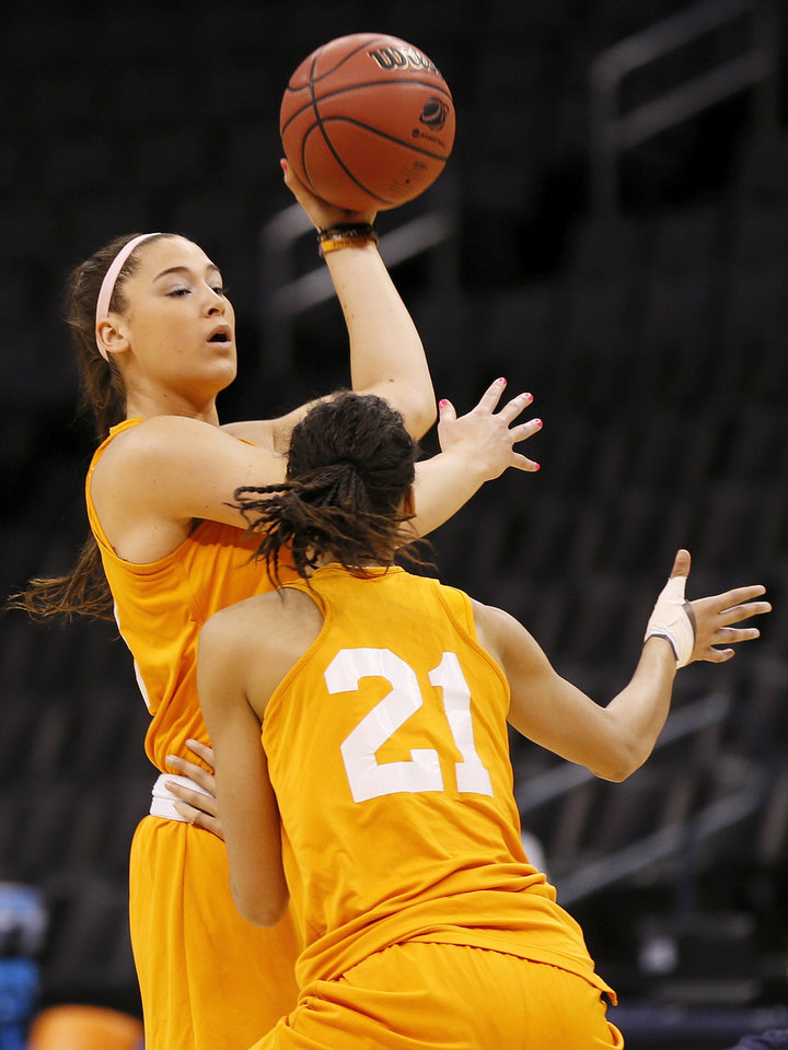 Tennessee\'s Taber Spani (13) looks to pass around Nia Moore (21) while running a drill during the press conference and practice day at the Oklahoma City Regional for the NCAA women\'s college basketball tournament at Chesapeake Energy Arena in Oklahoma City, Saturday, March 30, 2013. Photo by Nate Billings, The Oklahoman