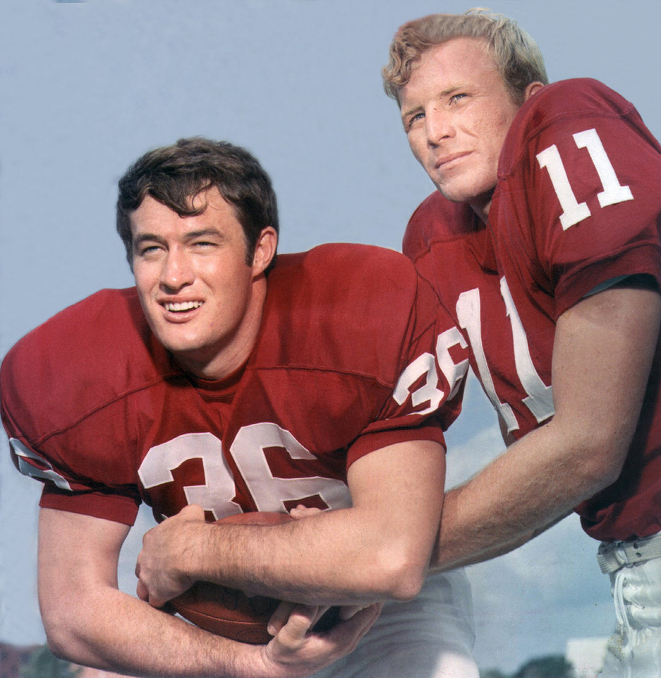 Photo - COLLEGE FOOTBALL: Posed color photo of University of Oklahoma running back Steve Owens (left) and OU quarterback Jack Mildren.  Photo may have been taken in August of 1969 during OU Media Day. Staff photo by Al McLaughlin ran in the 10/11/69 and 12/26/69 Daily Oklahomans.