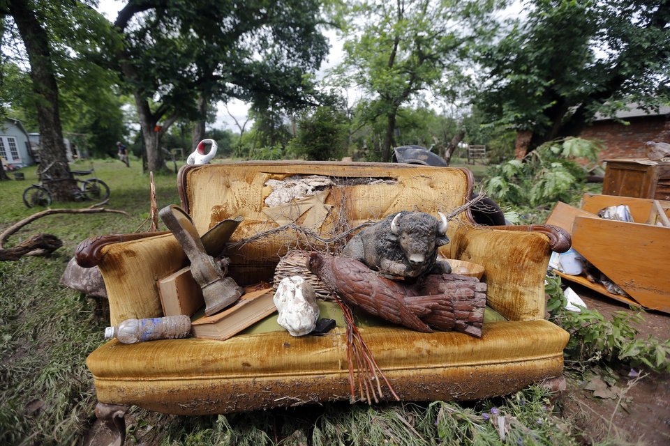 Photo - Damaged items at the Easter property is pictured after the West Cache Creek overflowed flooding the area in Cache, Okla., Sunday, May 24 2015.  Easter and his family were rescued from their roof early Sunday as floods surrounded the home. Photo by Sarah Phipps, The Oklahoman