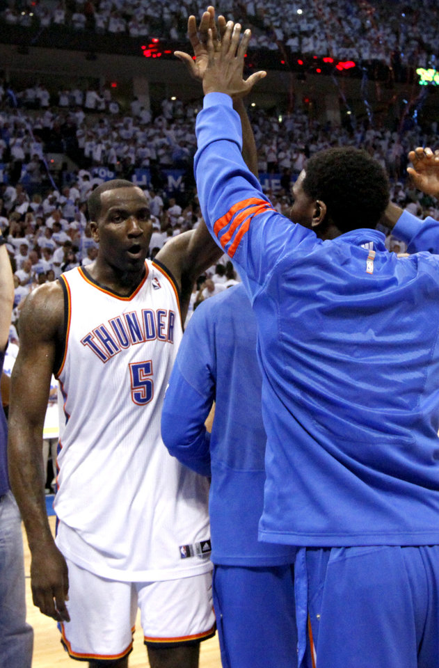 Photo - Kendrick Perkins (5) celebrates following Game 2 of the first round in the NBA basketball playoffs between the Oklahoma City Thunder and the Dallas Mavericks at Chesapeake Energy Arena in Oklahoma City, Monday, April 30, 2012. Photo by Sarah Phipps, The Oklahoman