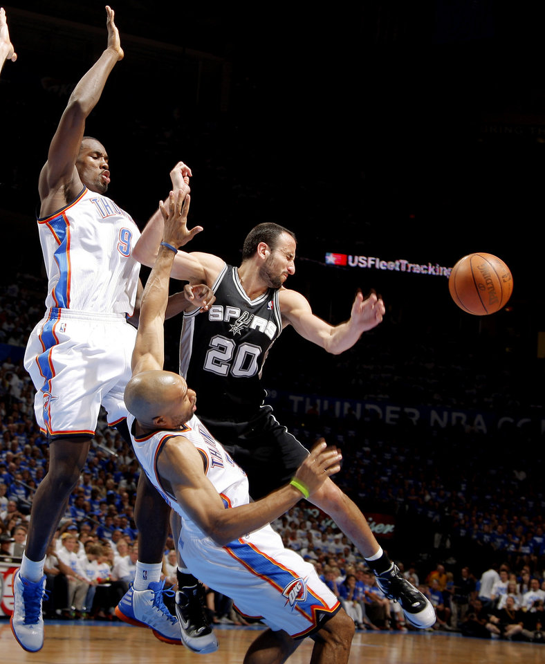 Photo - Oklahoma City's Serge Ibaka (9) and Derek Fisher (37) defend San Antonio's Manu Ginobili (20) during Game 4 of the Western Conference Finals between the Oklahoma City Thunder and the San Antonio Spurs in the NBA playoffs at the Chesapeake Energy Arena in Oklahoma City, Saturday, June 2, 2012. Oklahoma CIty won 109-103. Photo by Bryan Terry, The Oklahoman