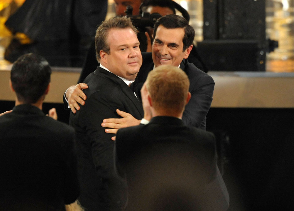 Photo -   Ty Burrell, right, congratulates Eric Stonestreet after Stonestreet won the award for outstanding supporting actor in a comedy series for