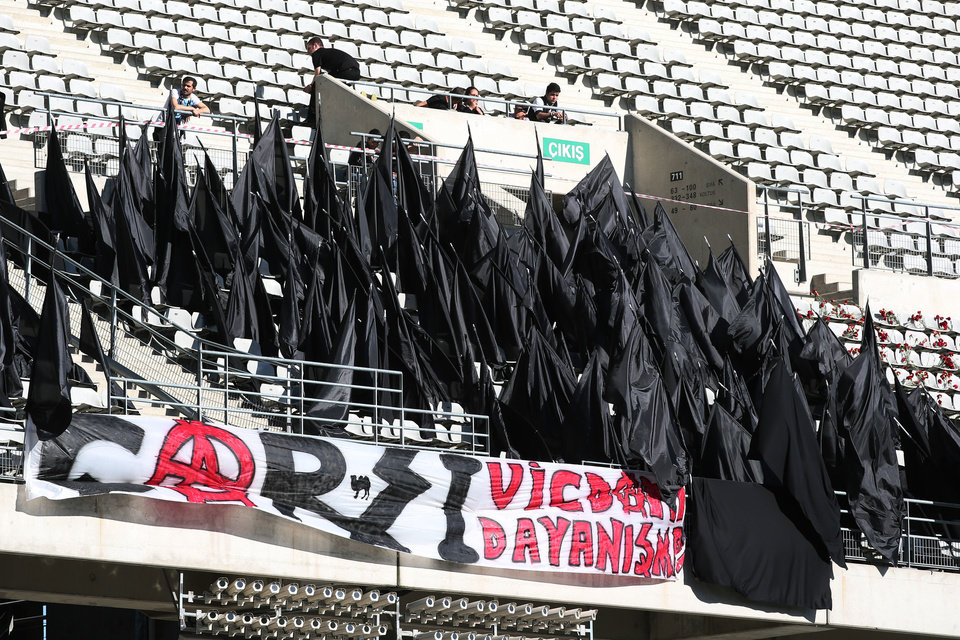 Photo - Supporters of Besiktas stand black flags to express their condolences for the victims of Soma mine accident before their Turkish League match in Istanbul, Turkey, Saturday, May 17, 2014. Turkey's Energy Minister Taner Yildiz said Saturday that crews had found more bodies overnight, raising the death toll to 301. An explosion and fire at a coal mine in Soma, some 250 kilometers (155 miles) south of Istanbul, killed hundreds of workers in one of the worst mining disasters in Turkish history. (AP Photo)