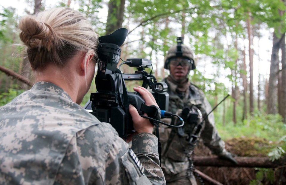 Photo -  SecondLt. Leanna Litsch, of Altus, interviews a soldier in Rukla, Lithuania, on June 14. Litsch belongs to the 145th Mobile Public Affairs Detachment, which was sent to four countries to tell the story of the 173rd Airborne Brigade and their training in the Baltic region. PHOTO BY SGT. DANIEL NELSON, OKLAHOMA ARMY NATIONAL GUARD   Sgt. Daniel Nelson -  Sgt. Daniel Nelson, 145 MPAD, Oklahoma Army National Guard