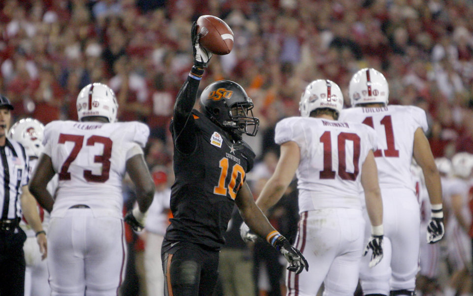 Photo - Oklahoma State's Markelle Martin (10) celebrates a fumble recovery during the Fiesta Bowl between the Oklahoma State University Cowboys (OSU) and the Stanford Cardinal at the University of Phoenix Stadium in Glendale, Ariz., Monday, Jan. 2, 2012. Photo by Sarah Phipps, The Oklahoman