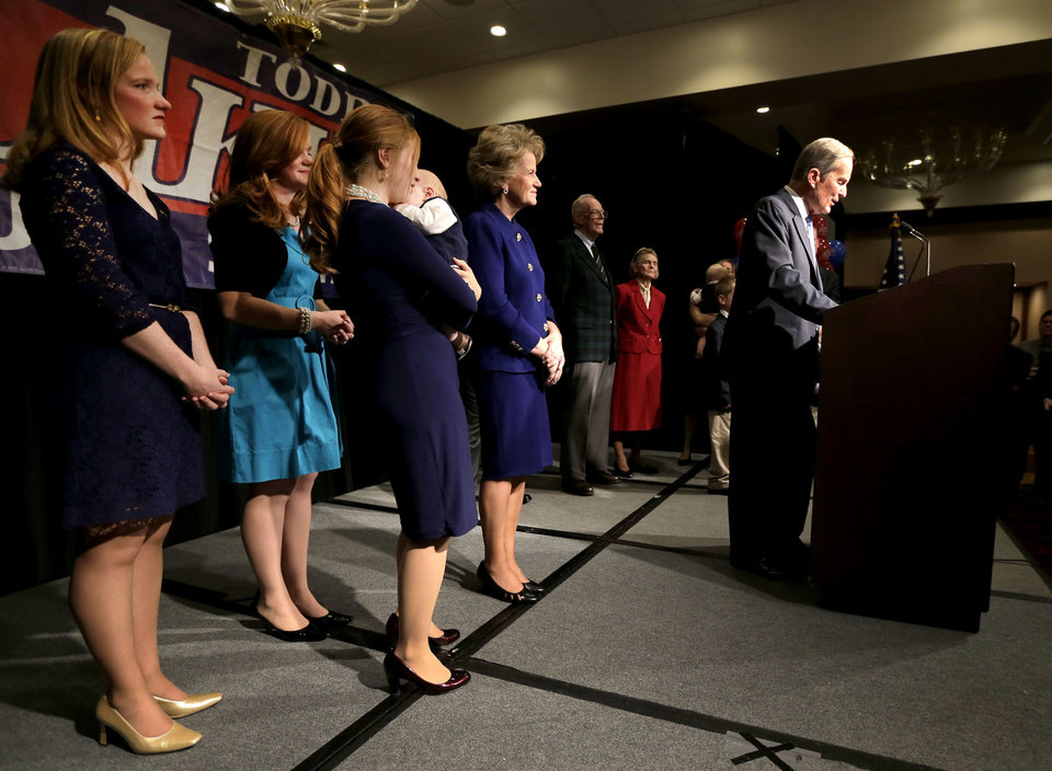 U.S. Senate candidate, Rep. Todd Akin, R-Mo., is backed by family members as he gives his concession speech to U.S. Sen. Claire McCaskill, D-Mo. Tuesday, Nov. 6, 2012, in Chesterfield, Mo. (AP Photo/Charlie Riedel)