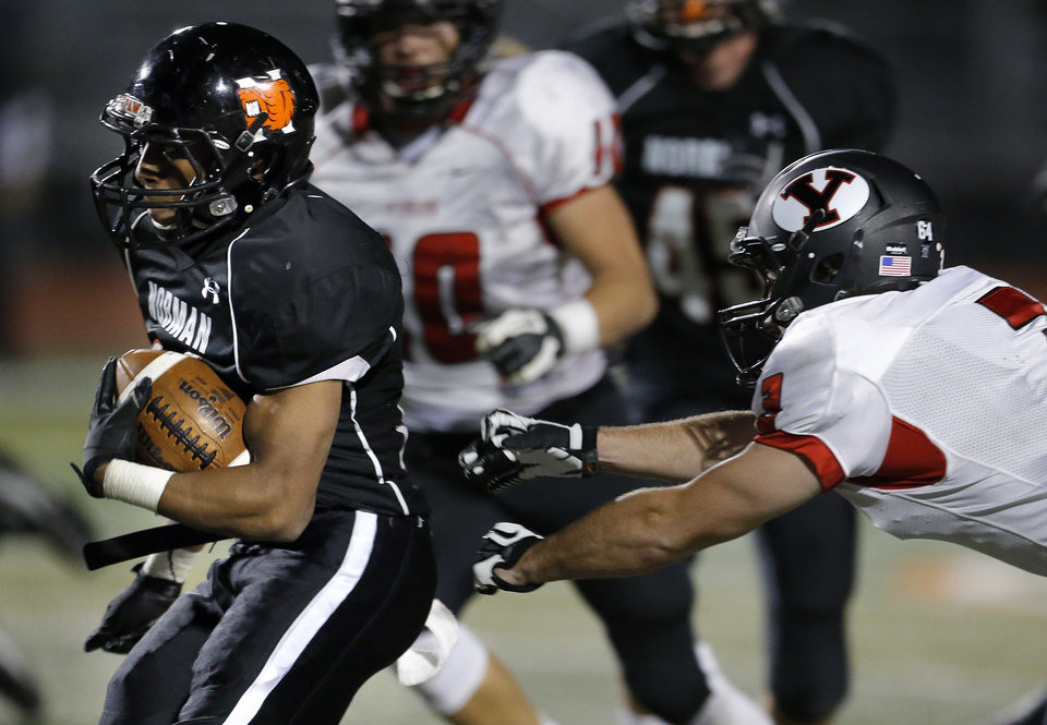 Photo - Norman's Imond Robinson gets by Yukon's Chance Keggett during the high school football game between Norman and Yukon at Norman High School in Norman, Okla., Thursday, Nov. 8, 2012. Photo by Sarah Phipps, The Oklahoman