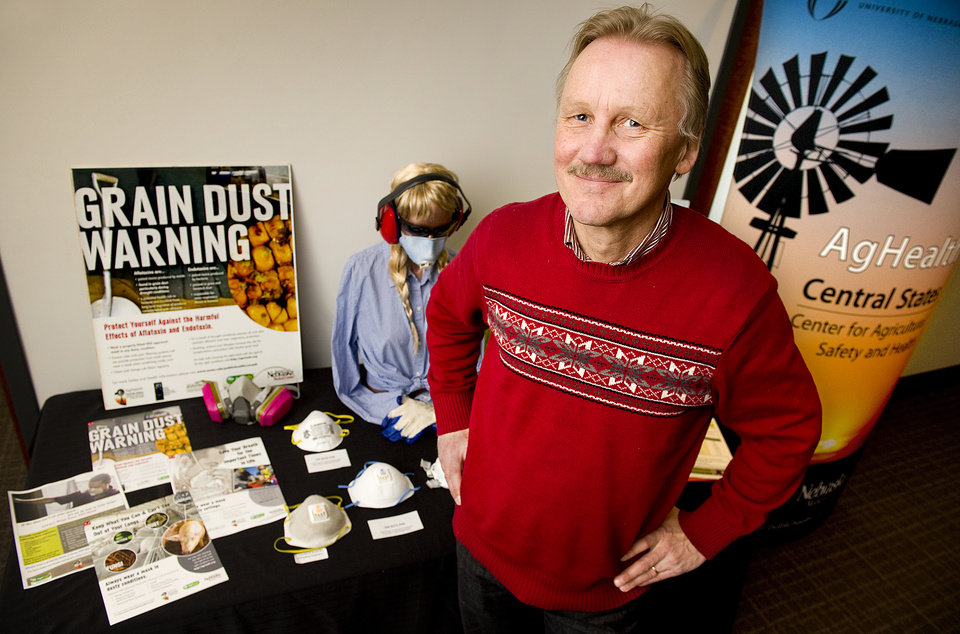 ADVANCE FOR WEEKEND EDITIONS FEB. 23-24 - In this Feb. 19, 2013 photo, Risto Rautiainen , Ph.D., the director of the Central States Center for Agricultural Safety and Health, stands before a demonstration table for displaying hearing and respiratory devices to help illustrate the problems of sustained levels of noise and dust on farms at the Center of Public Health at the University of Nebraska Medical Center in Omaha, Neb. (AP Photo/The Journal-Star, Francis Gardler) LOCAL TV OUT; KOLN-TV OUT; KGIN-TV OUT; KLKN-TV OUT
