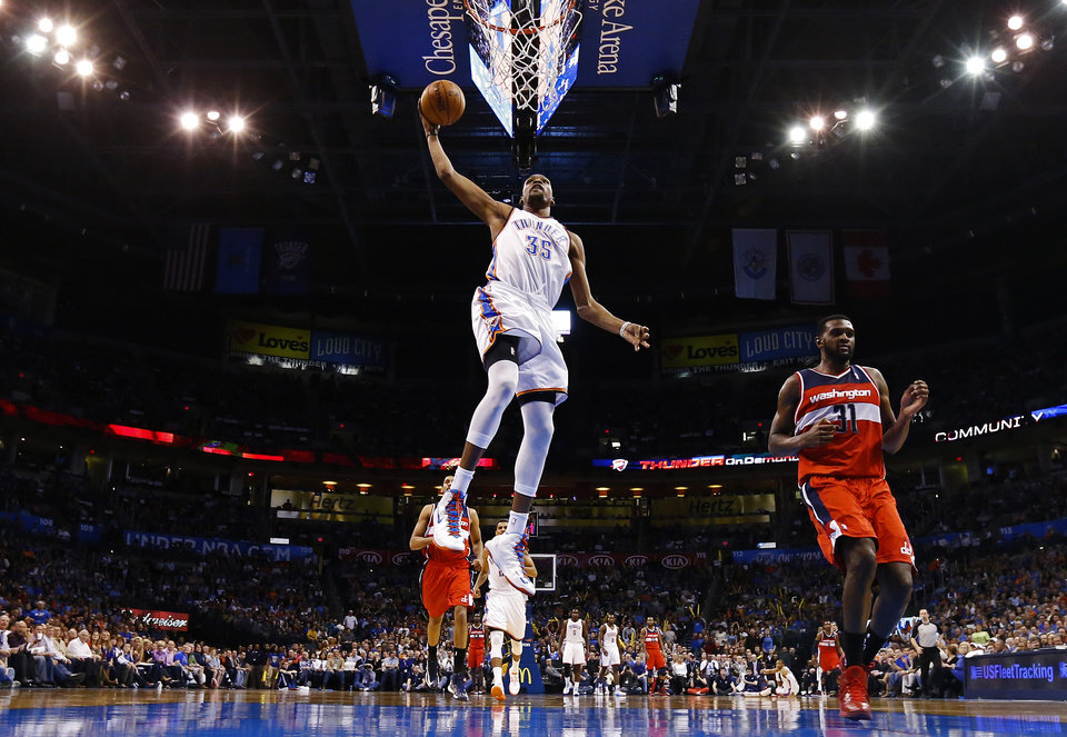 Oklahoma City\'s Kevin Durant (35) dunks the ball beside Washington\'s Chris Singleton (31) during an NBA basketball game between the Oklahoma City Thunder and the Washington Wizards at Chesapeake Energy Arena in Oklahoma City, Wednesday, March 19, 2013. Photo by Bryan Terry, The Oklahoman