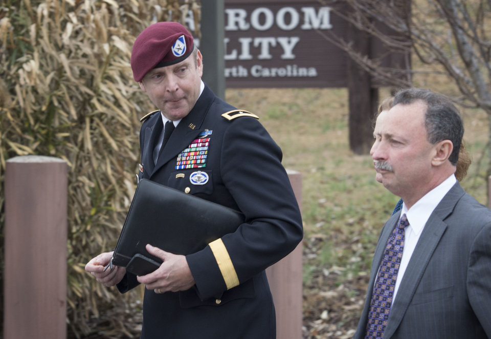 Photo - Brig. Gen. Jeffrey Sinclair, left,  leaves the Fort Bragg courthouse, Monday, March 17, 2014 with his defense attorney Richard Scheff.  Sinclair, who admitted to improper relationships with three subordinates appeared to choke up as he told a judge that he'd failed the female captain who had leveled the most serious accusations against him. (AP Photo/The Fayetteville Observer, Johnny Horne)