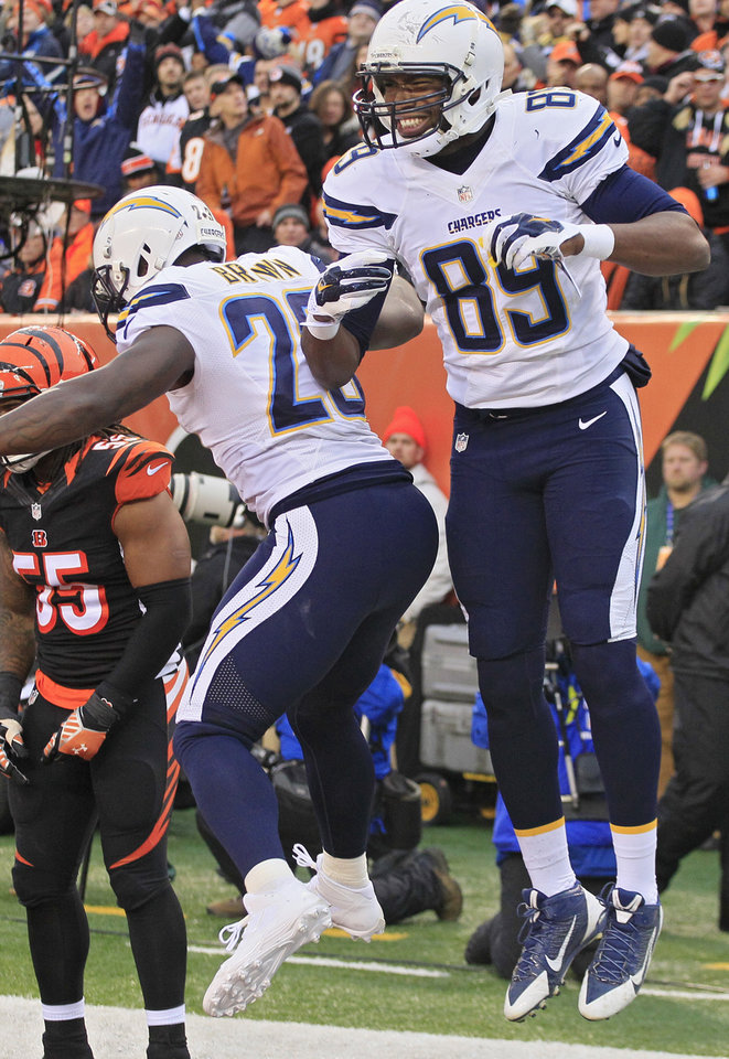 Photo - San Diego Chargers tight end Ladarius Green (89) celebrates his 4-yard touchdown catch against the Cincinnati Bengals with running back Ronnie Brown (23) in the second half of an NFL wild-card playoff football game on Sunday, Jan. 5, 2014, in Cincinnati. (AP Photo/Tom Uhlman)