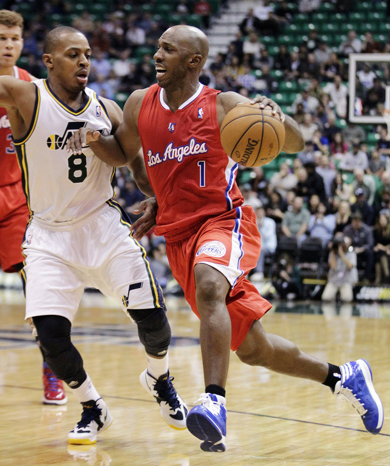 Los Angeles Clippers point guard Chauncey Billups (1) drives to the basket as Utah Jazz guard Randy Foye (8) defends in the first quarter of an NBA basketball game, Monday, Dec. 3, 2012, in Salt Lake City. (AP Photo/Rick Bowmer)