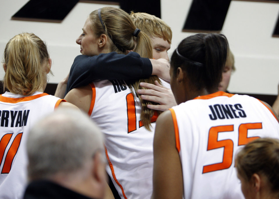 Photo - Oklahoma State's Heather Howard (13) hugs Brett Budke following the women's college game between Oklahoma State University and Coppin State at Gallagher-Iba Arena in Stillwater, Okla.,  Saturday, Nov. 26, 2011.  Photo by Sarah Phipps, The Oklahoman
