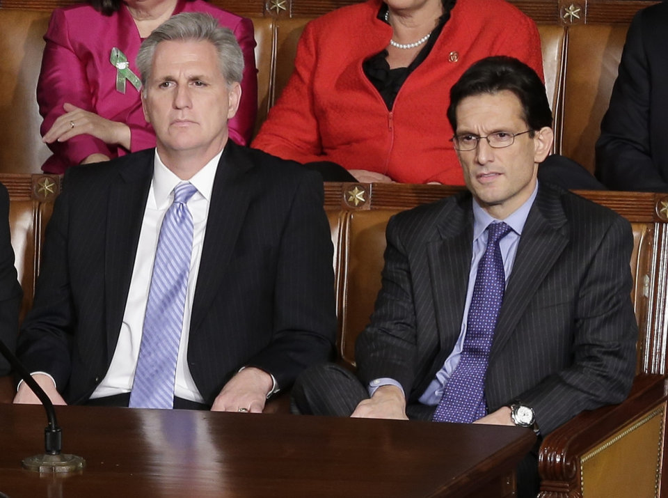House Majority Whip Kevin McCarthy of Calif. left, and House Majority Leader Eric Cantor listen during President Barack Obama's State of the Union address during a joint session of Congress on Capitol Hill in Washington, Tuesday Feb. 12, 2013. (AP Photo/J. Scott Applewhite) ORG XMIT: CAP116