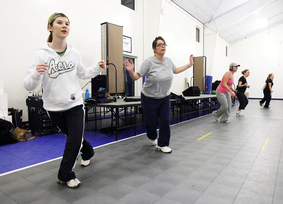 Photo - Lexi Knight, left, and her mother, Amanda, get a workout at the New Year's Day Boot Camp.