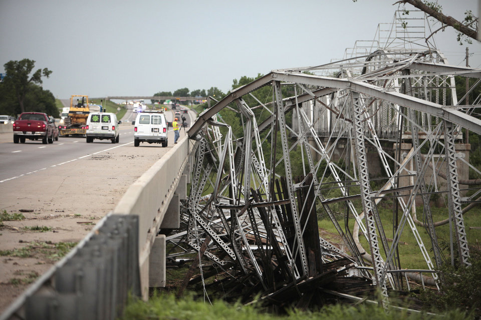 Photo - Tornado damage in Newcastle from May 20, 2013. The old steel bridge leans agents the new bridge over the Canadian River near Newcastle, Tuesday, May 21, 2013.  Photo By David McDaniel, The Oklahoman  David McDaniel - The Oklahoman