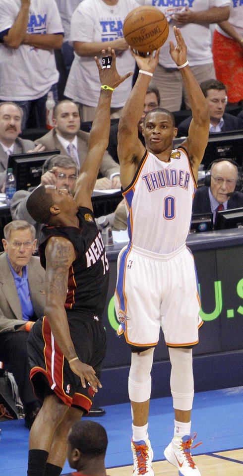 Oklahoma City's Russell Westbrook (0) shoots over Miami's Mario Chalmers (15) during Game 2 of the NBA Finals between the Oklahoma City Thunder and the Miami Heat at Chesapeake Energy Arena in Oklahoma City, Thursday, June 14, 2012. Photo by Chris Landsberger, The Oklahoman