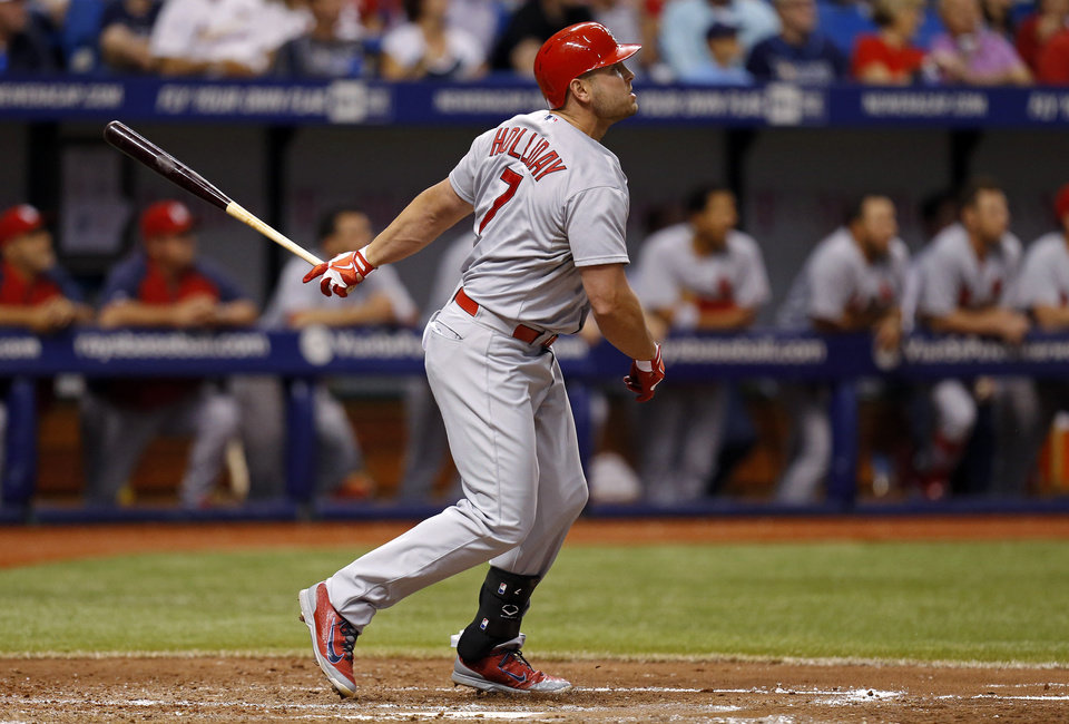 Photo - St. Louis Cardinals' Matt Holliday follows through on his solo home run during the sixth inning of a baseball game against the Tampa Bay Rays, Tuesday, June 10, 2014, in St. Petersburg, Fla. (AP Photo/Mike Carlson)