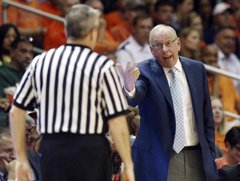 Photo - Syracuse coach Jim Boeheim, right, tells at an official after his team fouled Miami during the second half of an NCAA college basketball game in Coral Gables, Fla., Saturday, Jan. 25, 2014. Syracuse won 64-52. (AP Photo/J Pat Carter)