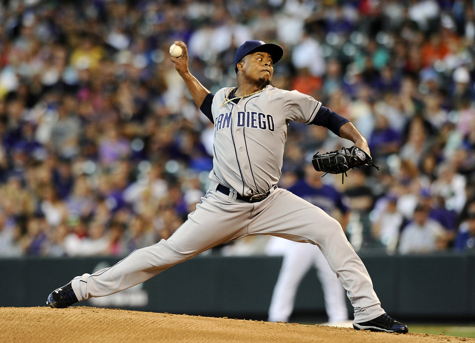 Photo - San Diego Padres starting pitcher Edinson Volquez throws in the first inning of a baseball game against the Colorado Rockies on Monday, Aug. 12, 2013 in Denver. (AP Photo/Chris Schneider)